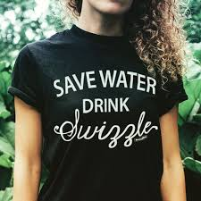 Girl with curly hair in a black t-shirt with white writing.
